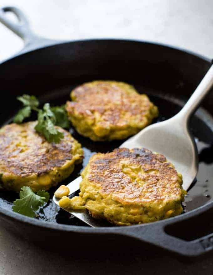 Corn Fritters frying in a pan