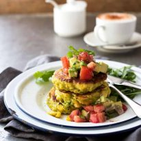 A stack of Bill Granger's Corn Fritters with Avocado Salsa