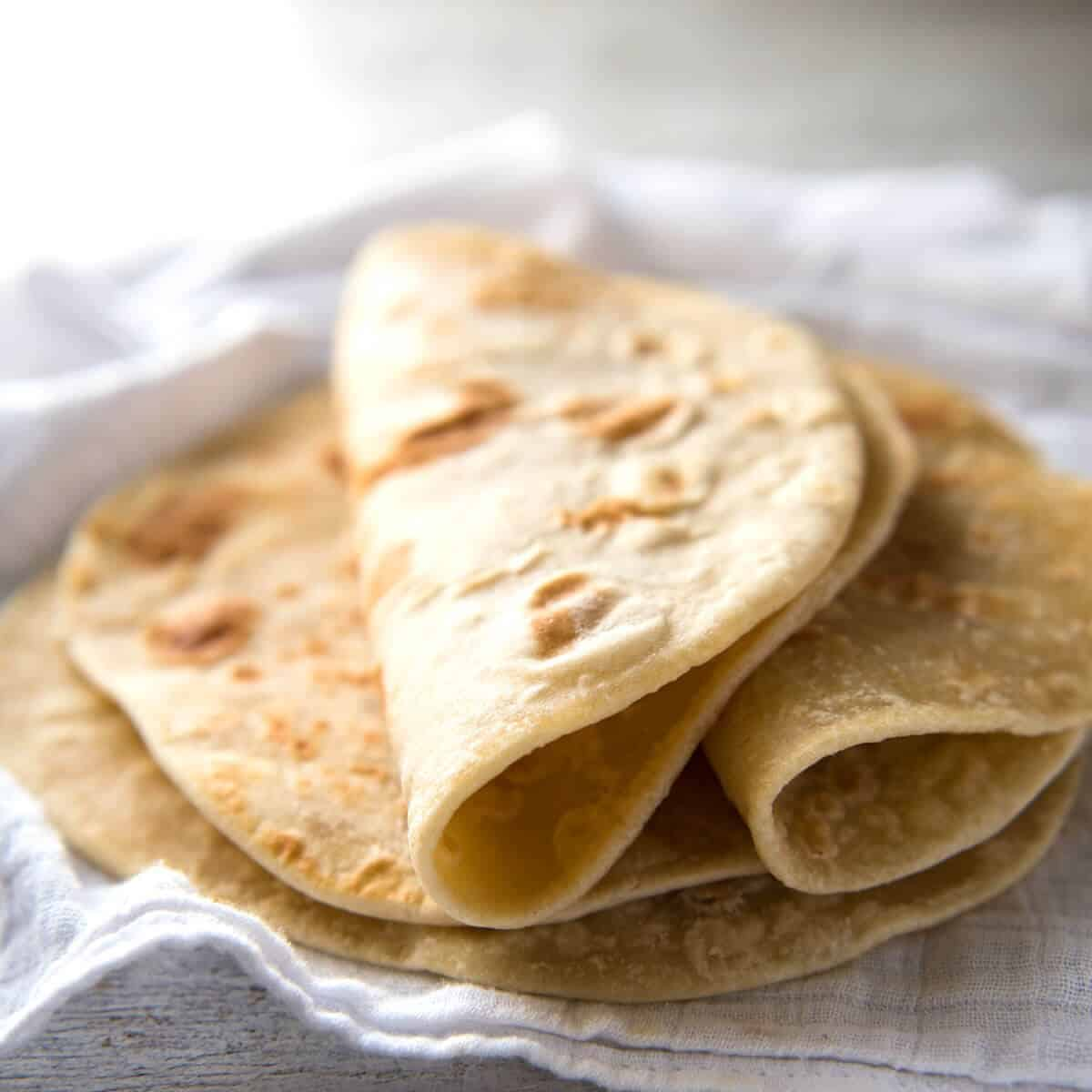 This flatbread recipe is made with out yeast, yet is gentle and pliable and wonderfully moist. recipetineats.com