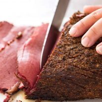 Easy homemade pastrami being sliced