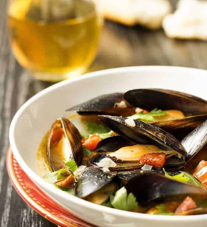 Mussels with Chorizo and White Wine - this takes all of 5 minutes to prep and 10 minutes to cook. Make sure you have plenty of crusty bread to mop up the delicious broth!