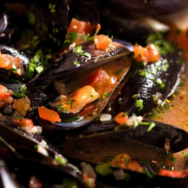 Close up of mussels with garlic white wine