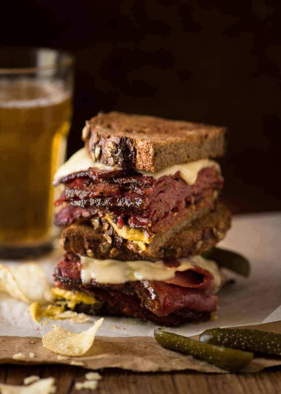 Easy Homemade Pastrami sandwich cut in half, stacked on top of each other.