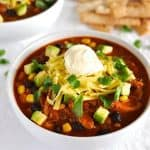 Shredded Chicken Enchilada Soup - made from scratch, 10 min prep, then set and forget in your slow cooker. This is a seriously drool worthy soup!