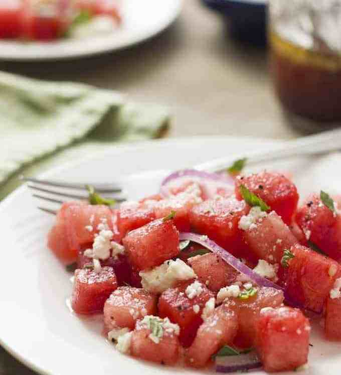 Watermelon Salad - as strange as it sounds, sweet, juicy watermelon with feta, red onion and mint is a winning combination. This summery, light salad is refreshing and is perfect for a summer barbeque.