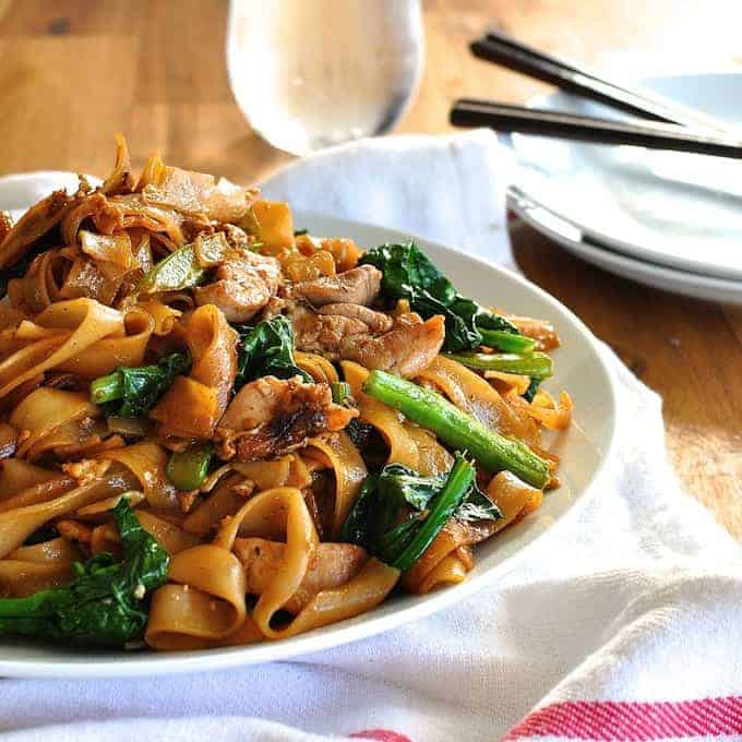 Pad See Ew, Thai stir fried noodles, a very popular Thai Street food, with chicken and Chinese Broccoli (kai-lan). On the table in 15 minutes.