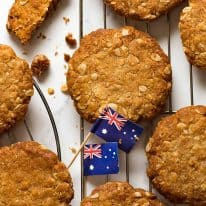 Overhead photo of Anzac biscuits on a cooling rack, fresh out of the oven