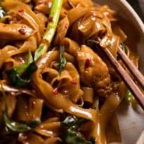 Close up of Thai Drunken Noodles with chopsticks