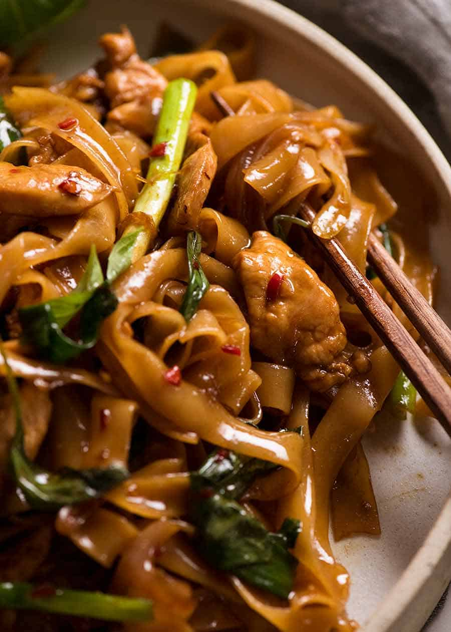 Close up of Thai Drunken Noodles with chopsticks