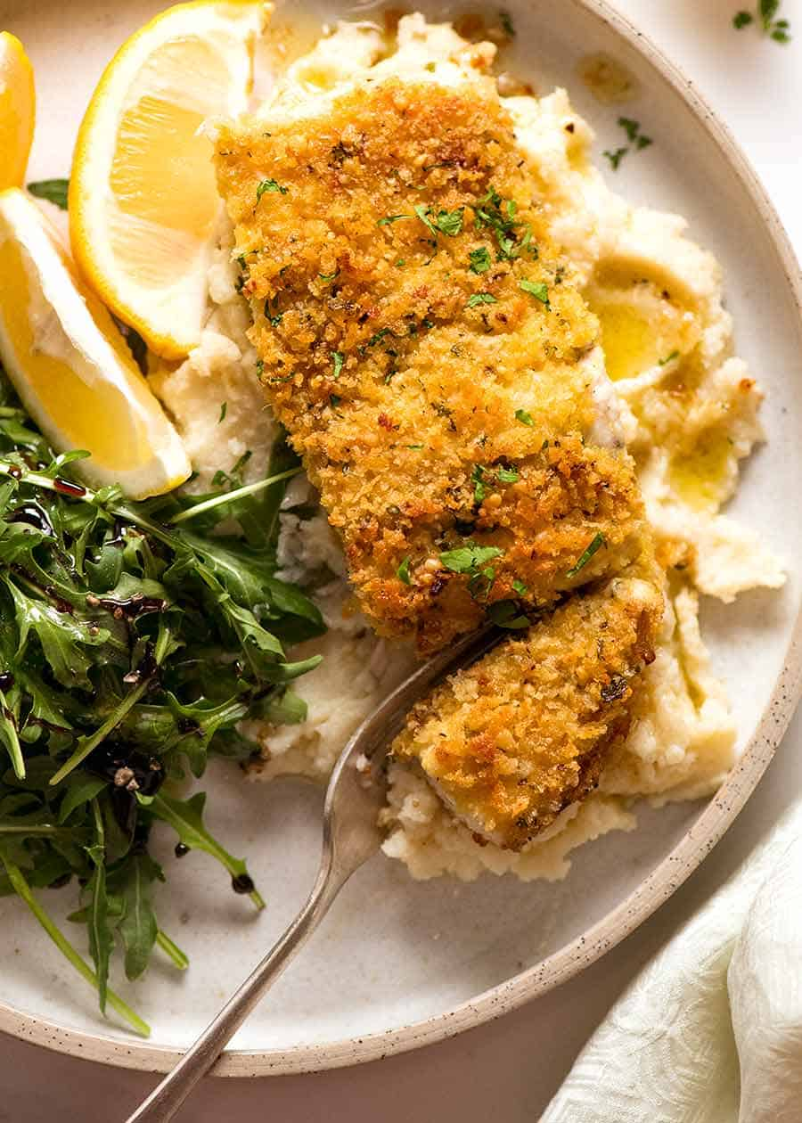 Overhead photo of Parmesan Crumbed Fish (easy baked fish recipe) on a plate, ready to be eaten