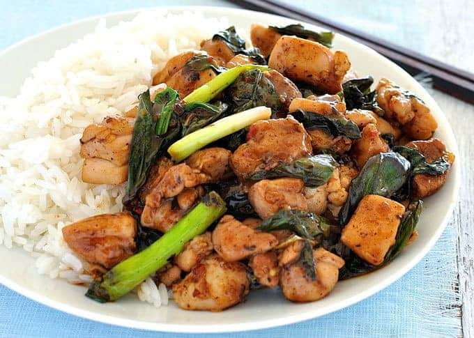 Thai Chilli Basil Chicken stir fry on a plate with rice