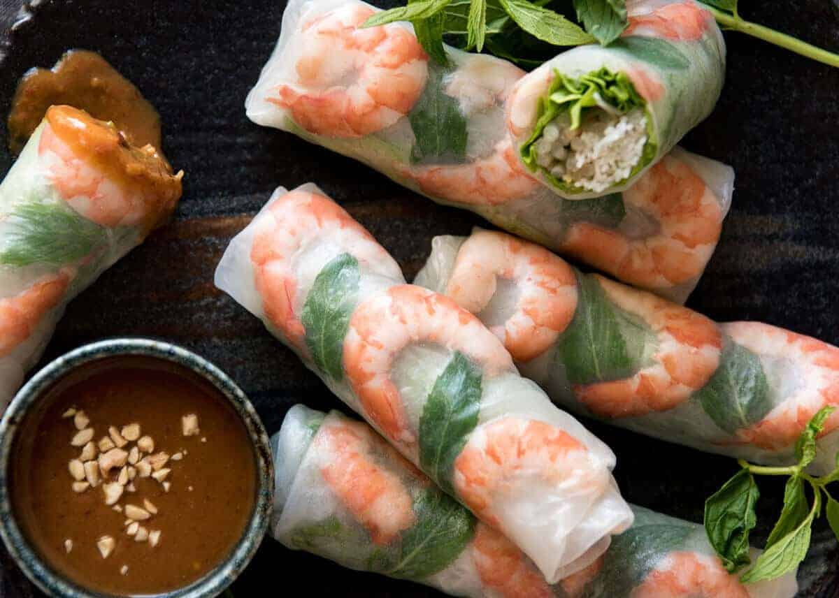 Jam packed with fresh, bright flavours, learn how to make Vietnamese Rice Paper Rolls with an easy to follow video tutorial and step by step photos. Served with an addictive Vietnamese Peanut Dipping Sauce! www.recipetineats.com
