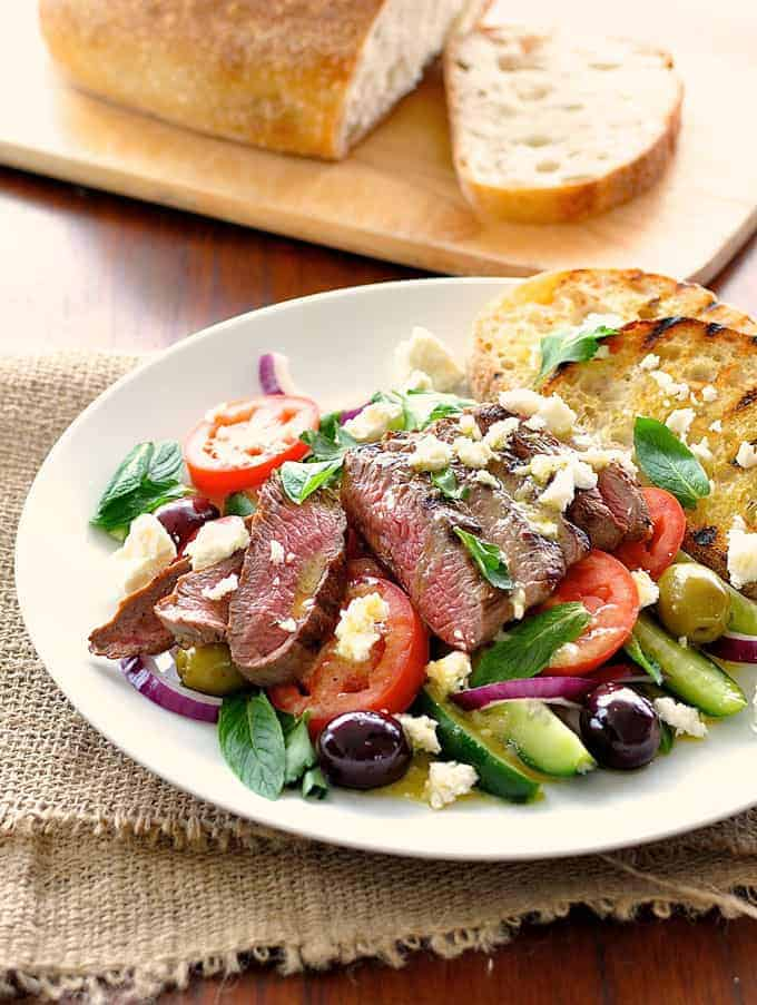 Greek Lamb and Salad Dinner on a white plate