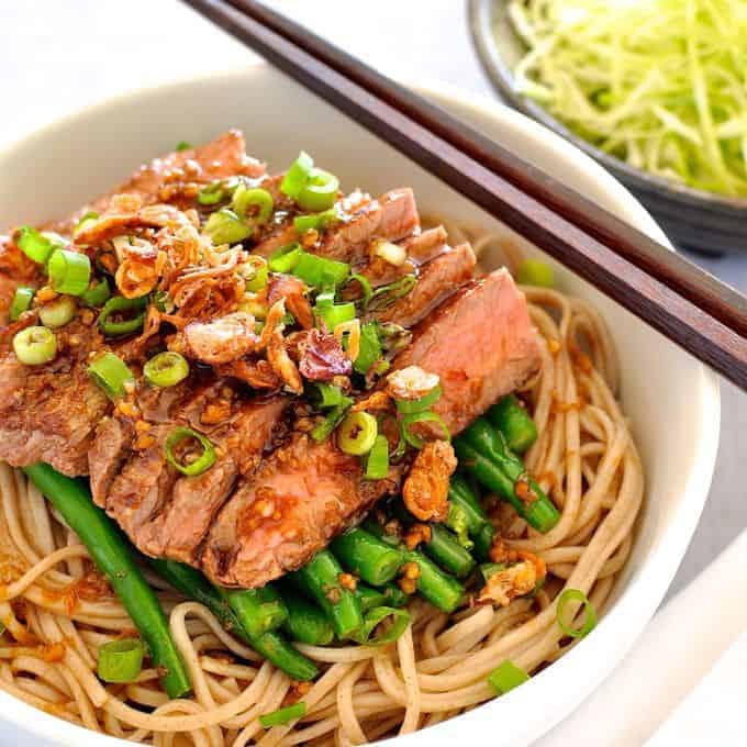 Soba with Green Beans and Beef in a bowl with chopsticks