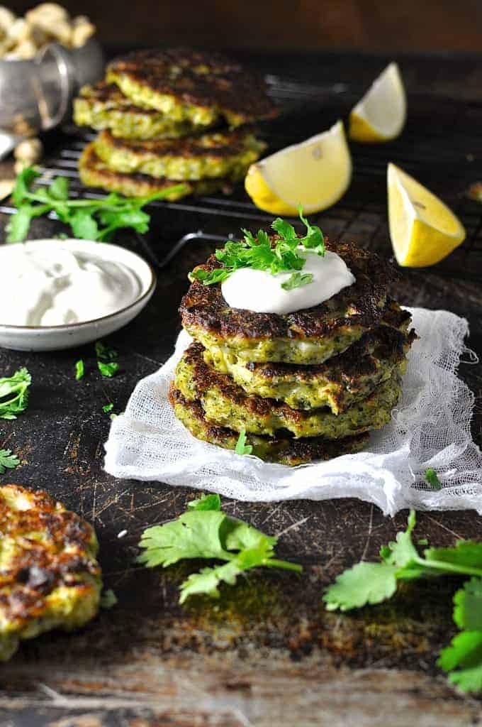 A stack of Broccoli Fritters with yoghurt sauce