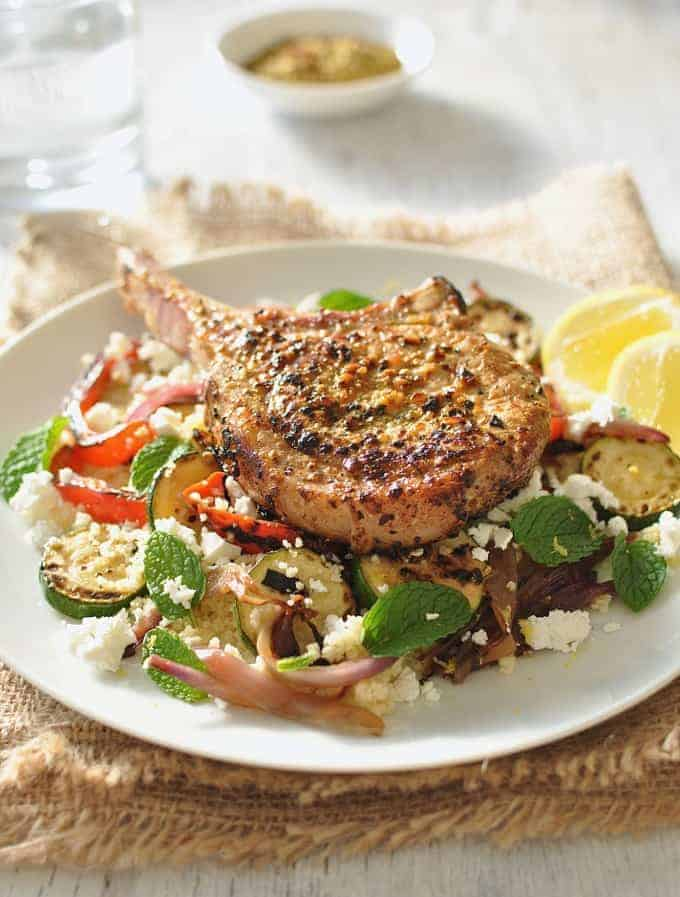 Lemon Pepper Pork with Grilled Veg and Feta Couscous closeup