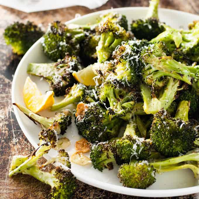 Roasted Broccoli on a white plate, ready to be served
