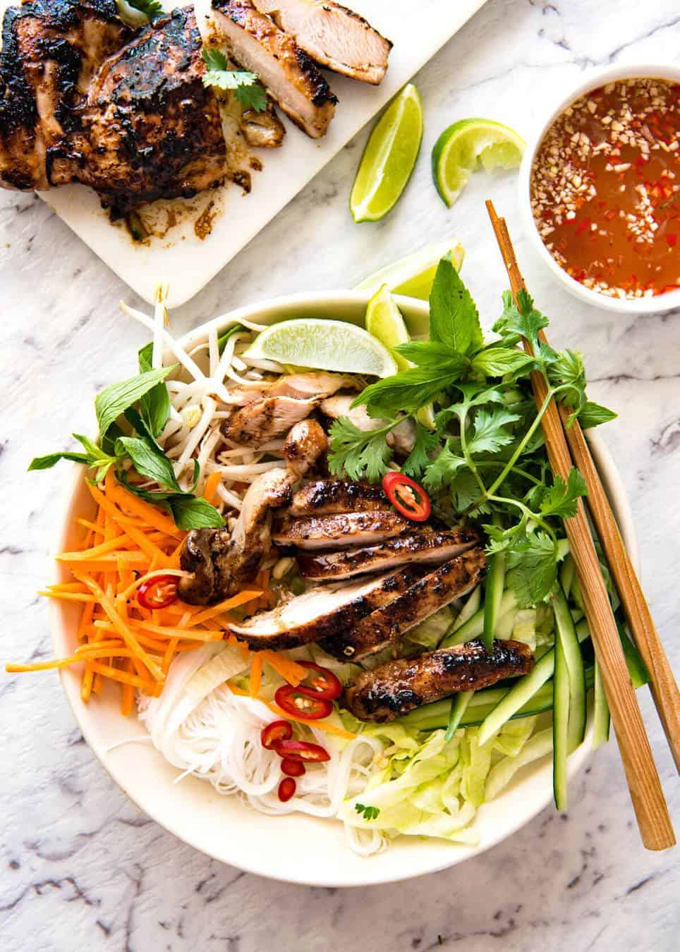 Vietnamese Noodles with Lemongrass Chicken (Bun Ga Nuong) - The popular Vietnamese dish made with Vermicelli noodles topped with fresh vegetables, lemongrass marinated chicken and drizzled with Nuoc Cham. Absolutely lip smackingly delicious! www.recipetineats.com