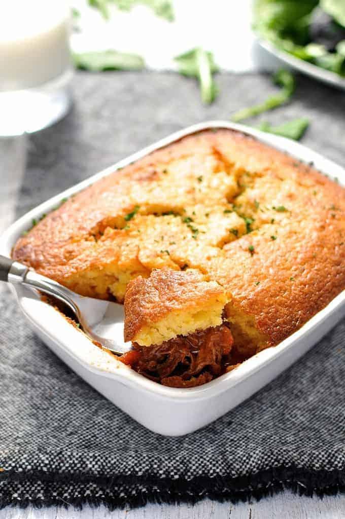 Chili Con Carne Corn Bread Pie in white baking dish