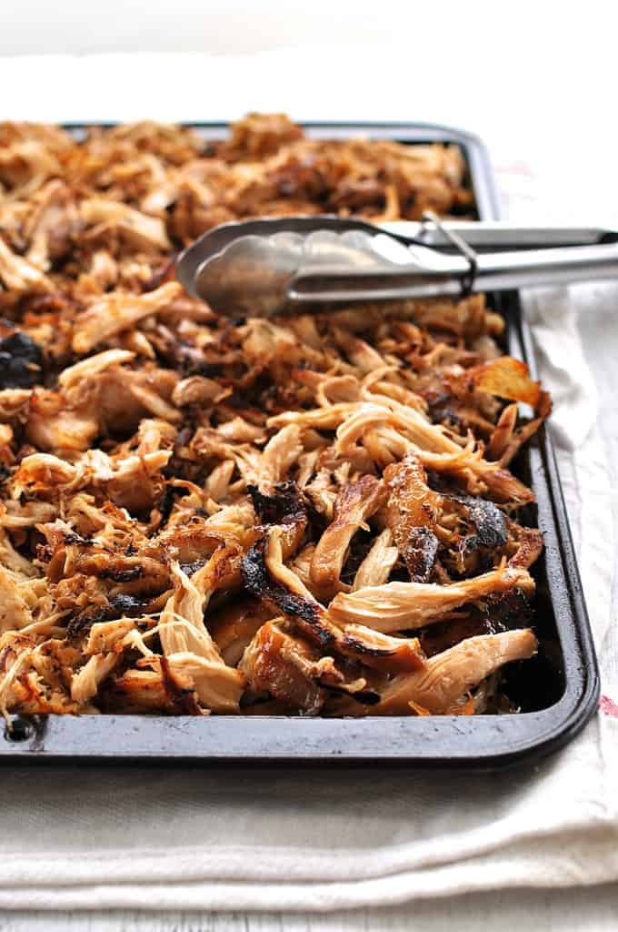 Crispy Chinese Shredded Chicken on a tray, fresh out from under the broiler.