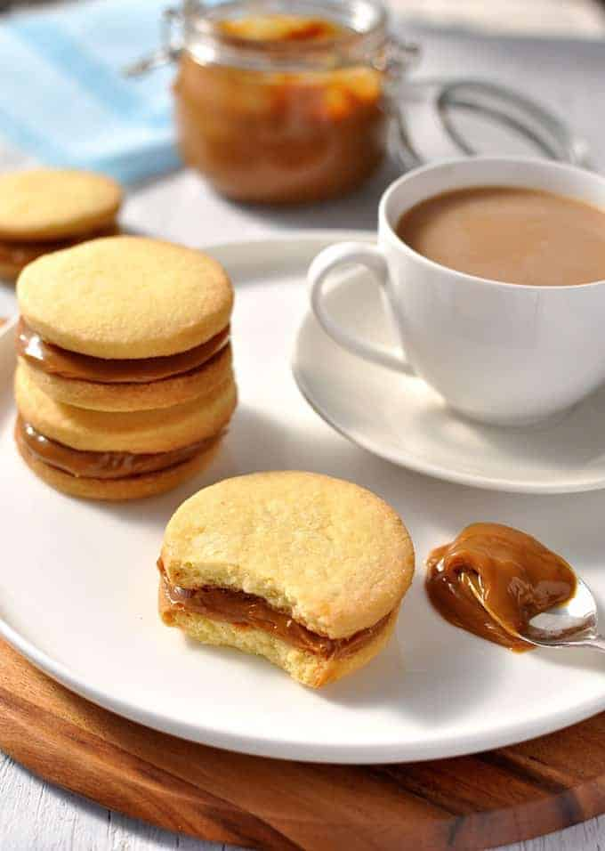 Shortbread Cookie Sandwiches with Dulce de Leche with bite taken out