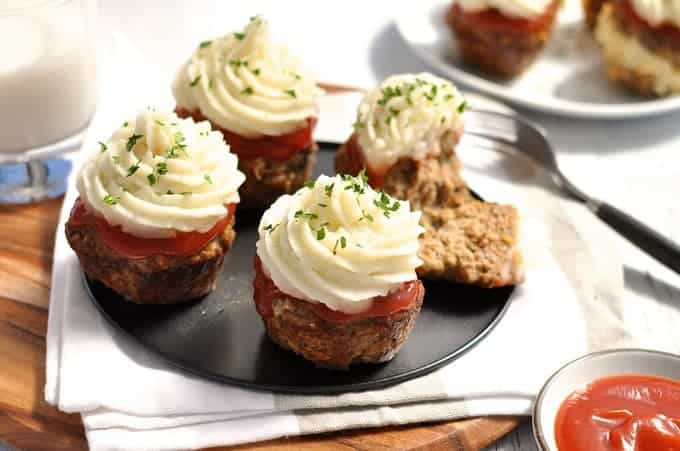 Meatloaf Cupcakes with Mashed Potato topping on a grey tray, ready to be served.