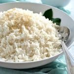 Fluffy coconut rice in a white bowl, ready to be served.