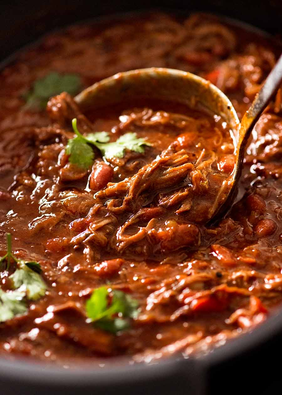 Close up of ladle scooping up Slow Cooker Shredded Beef Chili