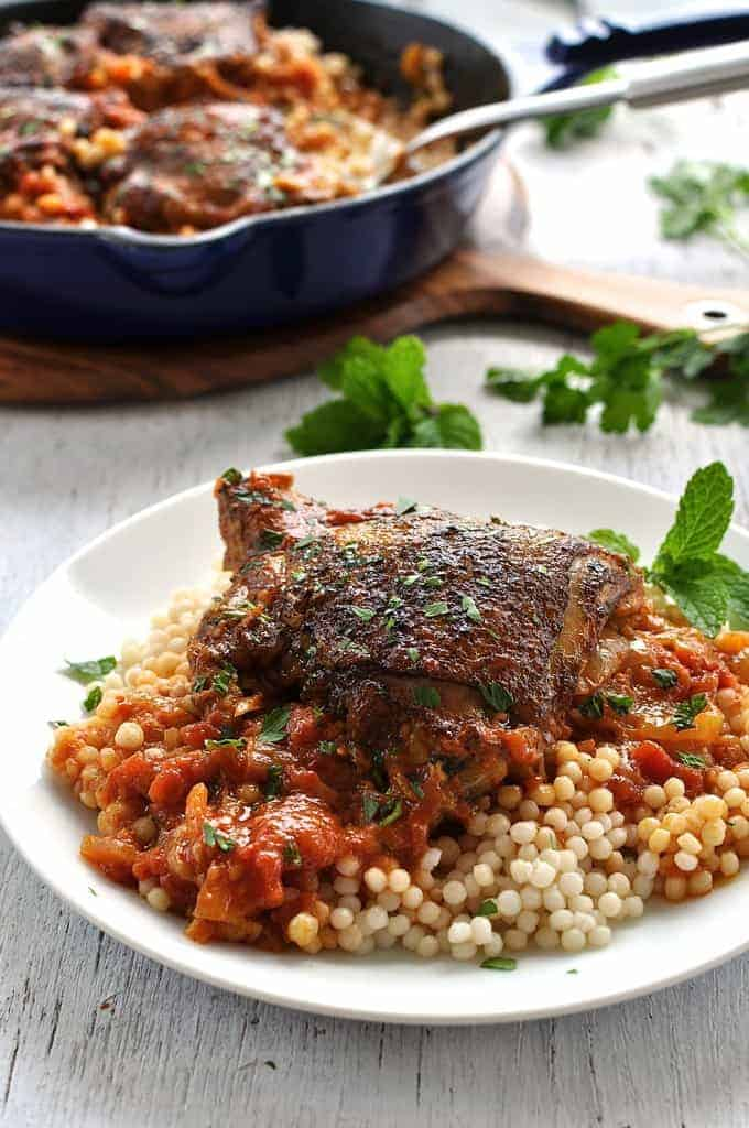 Syrian Chicken with Giant Couscous on white plate