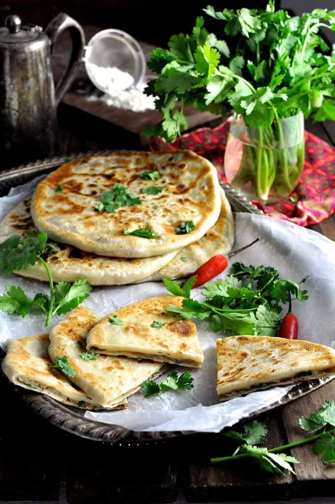 Aloo Paratha (Indian Potato Stuffed Flatbreads) - the bread is made ...