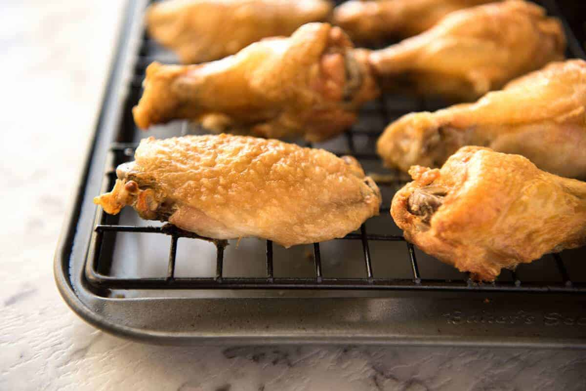 These oven baked wings are so crispy, you will think they've been deep fried! You will be shocked how easy these are to make! recipetineats.com
