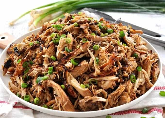 Pile of crispy Slow Cooker Chinese Shredded Chicken on a white plate