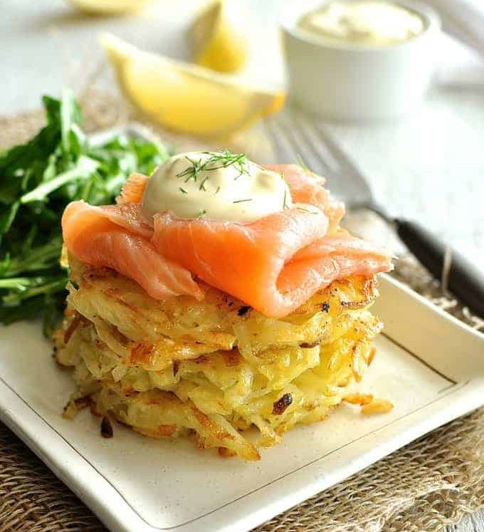 Smoked Salmon Potato Rosti Stack with a rocket salad and lemon wedges on the side