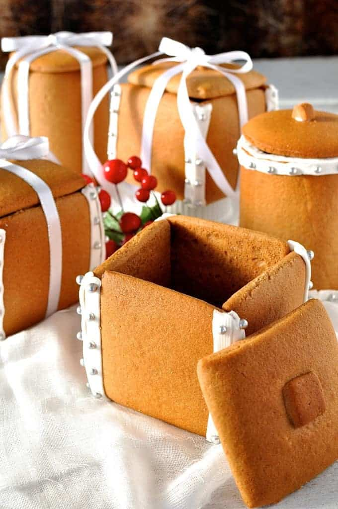Festive spread of Gingerbread Boxes and Mason Jars tied with ribbons and filled with chocolate truffle balls.