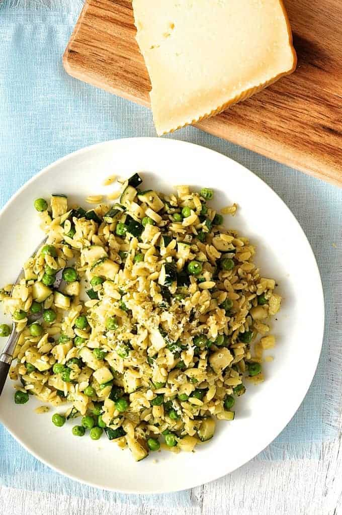 Green Vegetable Pesto Orzo (Risoni) - a complete meal loaded with greens that takes just 15 minutes to make. #orzo #risoni #fast #dinner #quick #pasta #zucchini #peas #pesto