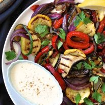 Grilled Vegetables Platter, a simple starter or vegetarian meal, on a white plate ready for serving.