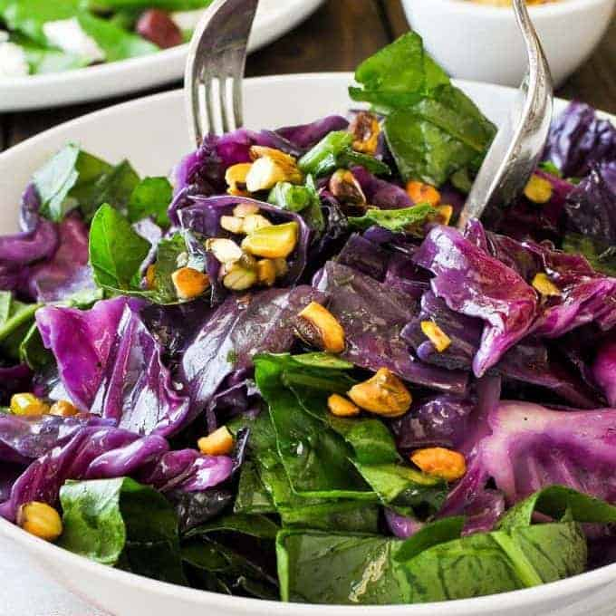 Warm Red Cabbage Salad with Garlic Butter being served