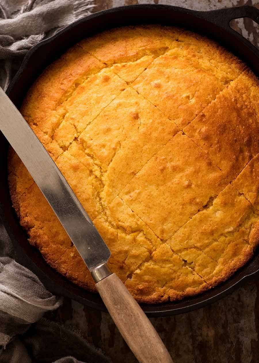 Overhead photo of Cornbread in a black skillet, fresh out of the oven