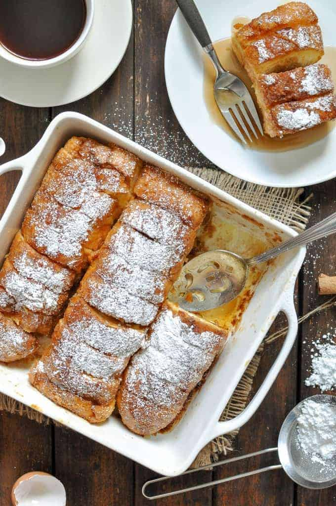 Hasselback Baked French Toast in a baking dish, hot out of the oven and ready to be served.