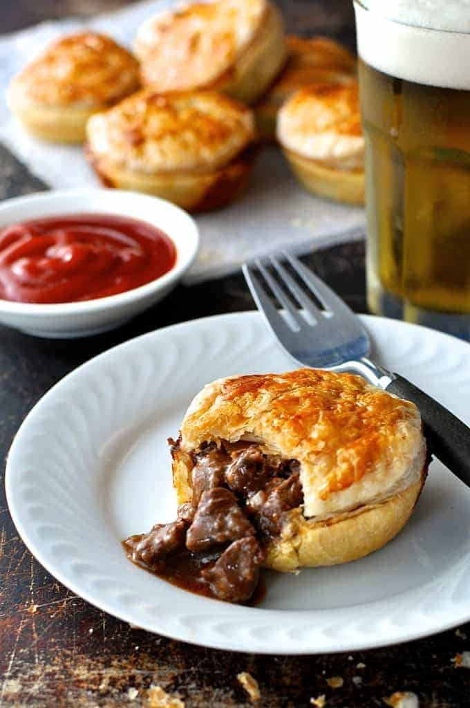 Party Pies and meat filling spilling from inside of one