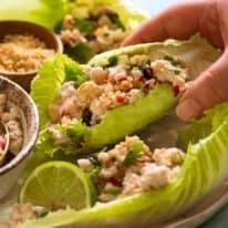 Hand picking up Thai Lettuce Wraps