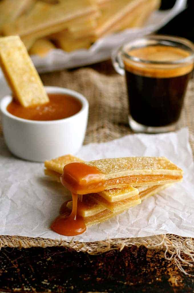 Baked Apple Pie Fries with Salted Caramel Dipping Sauce - everything you love about apple pie, in mini bite size form. Easy to make, fun to eat!