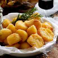 Truly Crunchy Roast Potatoes - par boil, rough up the surface, dust with semolina then bake in a very hot oven in preheated oil. Based on a Nigella recipe.