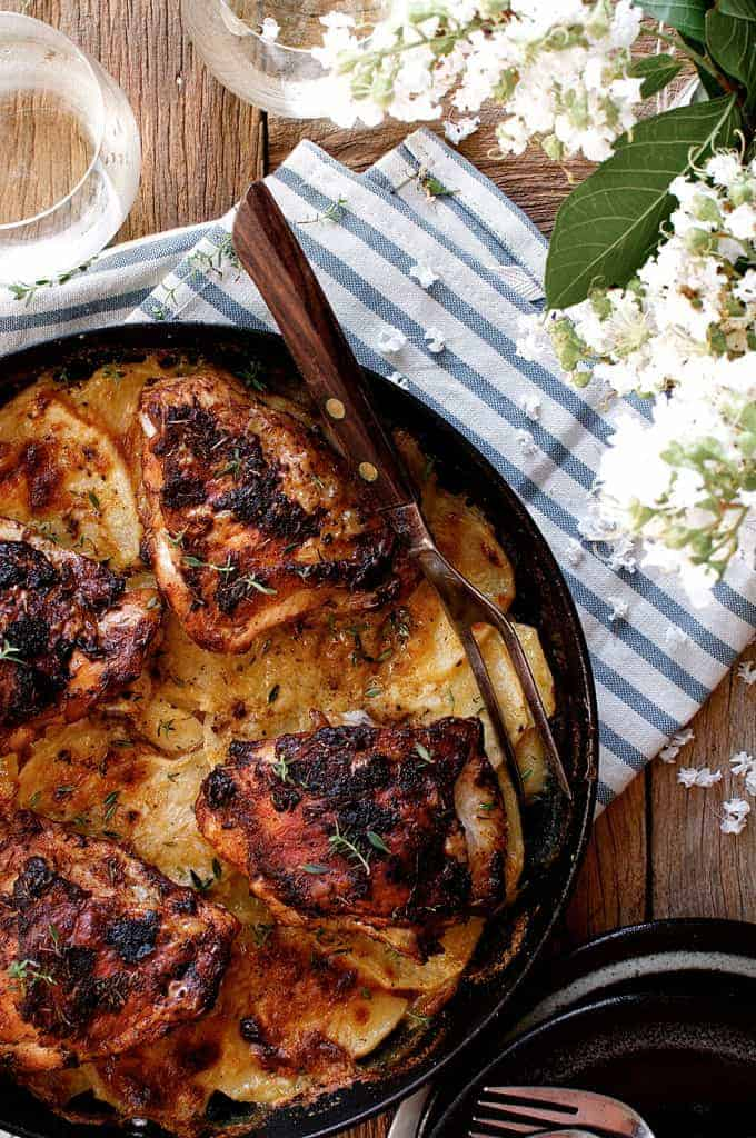 Overhead photo of a pan of Rotisserie Flavoured Chicken and Potato Bake with carving fork