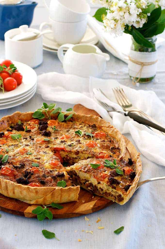 Table setting with whole Italian Sausage Quiche