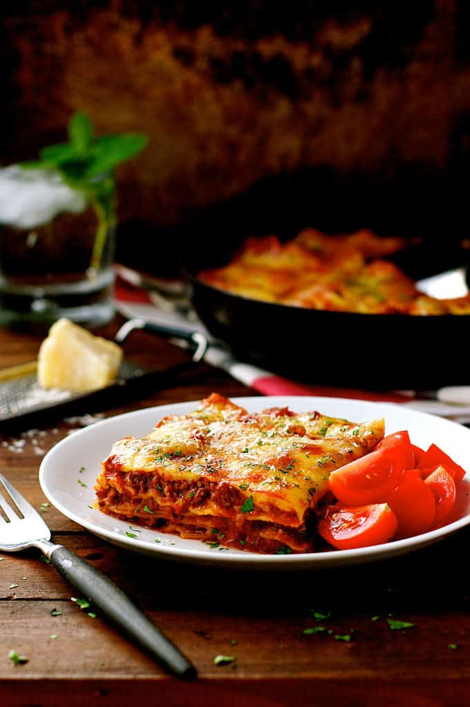 Plated One Pot Lasagna with tomatoes on the side