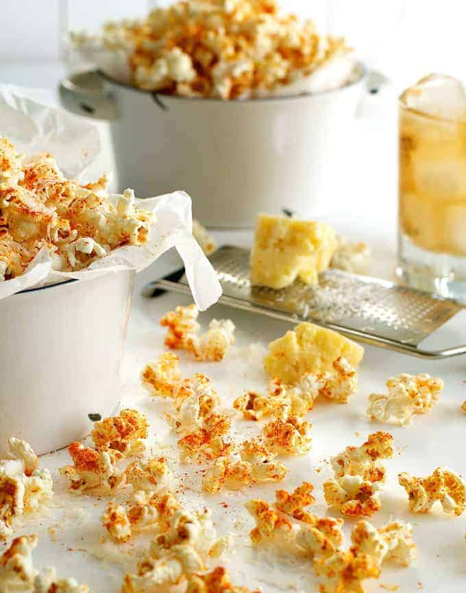 Spicy Parmesan Party Popcorn scattered on a table