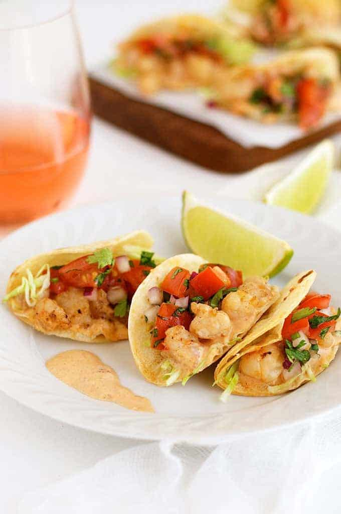 Bite Size Shrimp Tacos (Prawn) - the mini taco shells are made by draping cut tortilla rounds on the oven rack wires!! Filled with shrimp and a spicy adobo sauce.