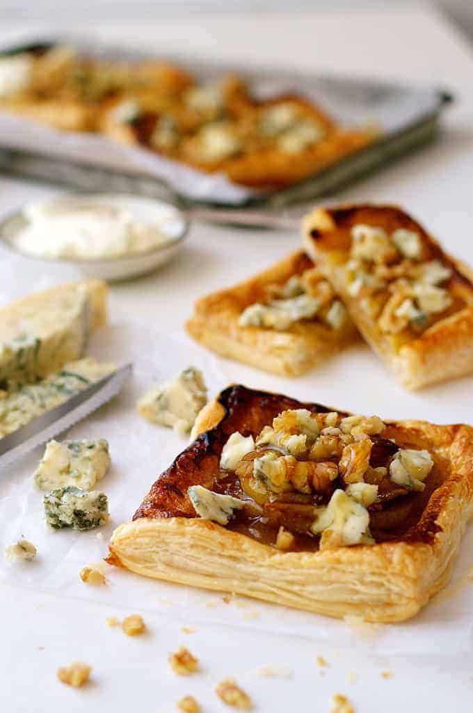 Caramelized Pear and Blue Cheese Tarts with crumbled cheese and walnuts