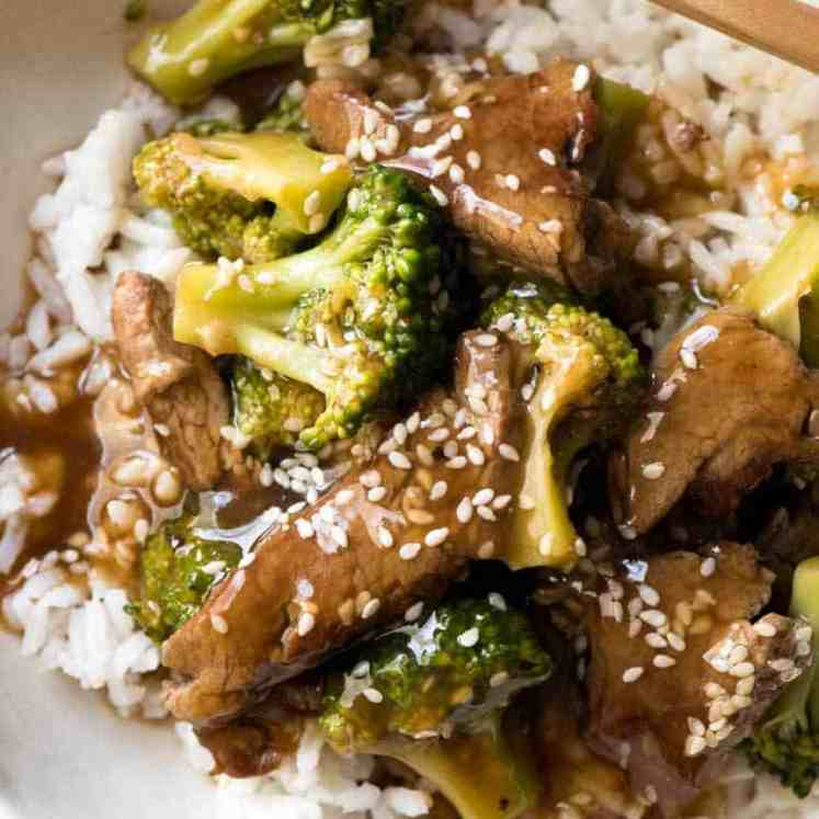 Chinese Beef and Broccoli in rice in a bowl, ready to be eaten.